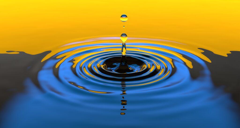 drop of water faling in sunlight
